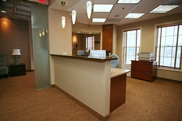 The front desk of Dr. Bradley J. Olson's office where we welcome all of our patients.