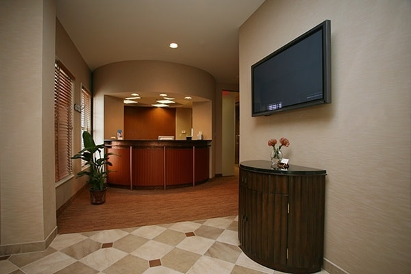 The lobby and front desk of Bradley J. Olson, DDS's office in Waldorf, MD.