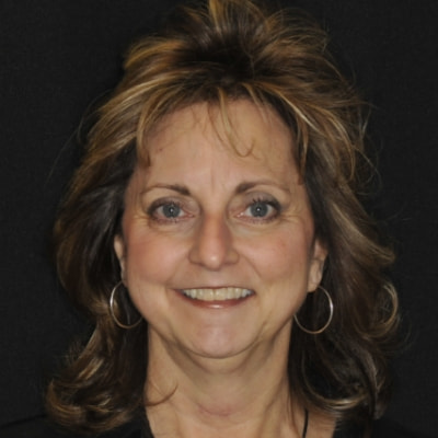 Headshot of Kathy, our office administrator