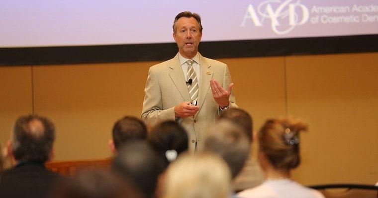 Dr. Olson giving a dental presentation