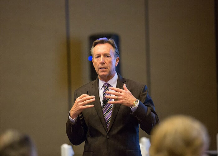 Dr. Bradley Olson speaking at an AACD event