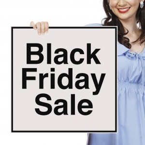 A woman holding a Black Friday Sale sign