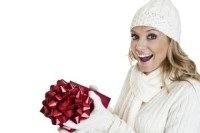Woman in white getting red present