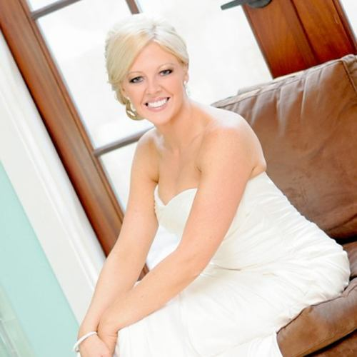 An actual patient of Dr. Bradley J. Olson on her wedding day, showing off her beautiful new smile.