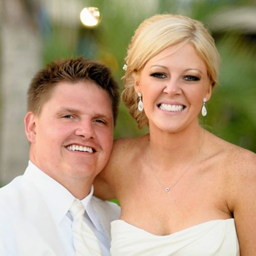 Actual patients of Dr. Bradley J. Olson on their wedding day, showing off their beautiful smiles.